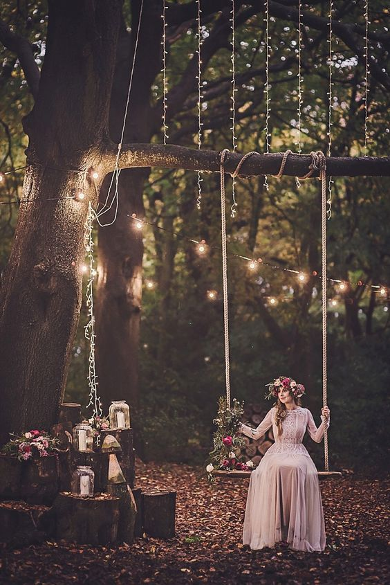 a simple rope swing with some bold blooms and herbs