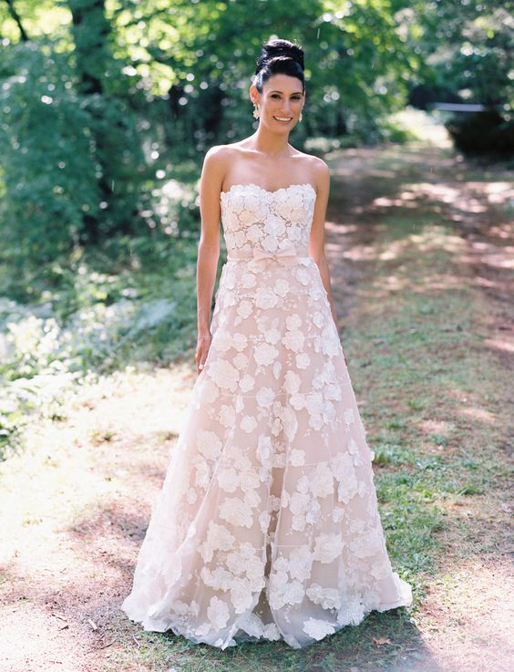 strapless blush wedding dress with white floral appliques