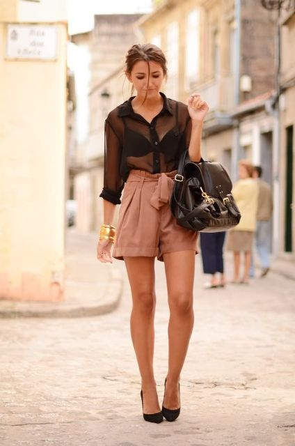 With sheer blouse, pumps and black bag