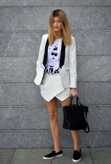 With t-shirt, black and white blazer, slip on shoes and black bag