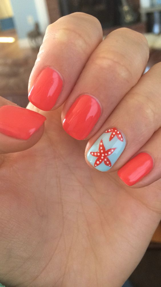 red nails and an accent nail in powder blue with starfish decor