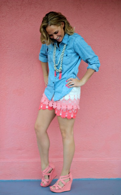 With denim shirt and pale pink sandals