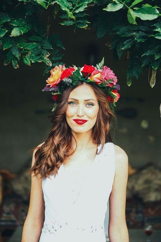 lush and bold summer floral crown with red and orange roses and fern