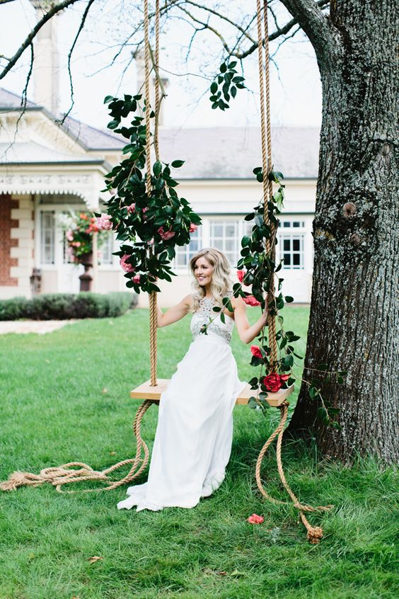 eye-catchy swing with bold red roses and leaves