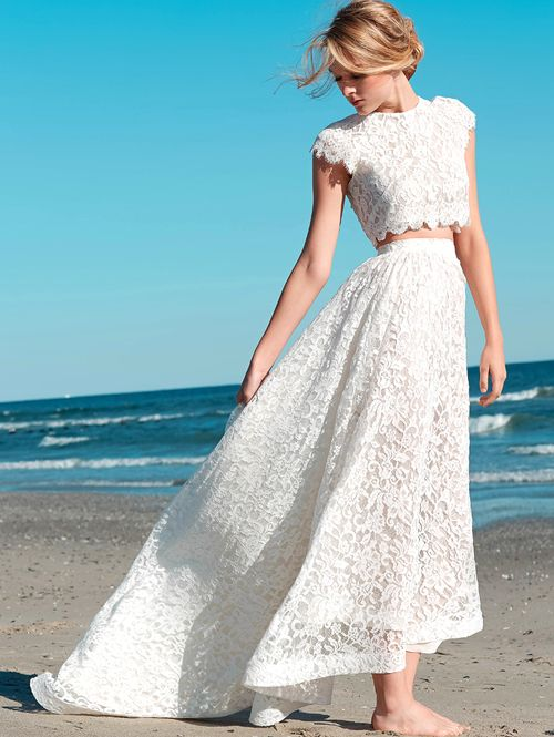 lace two piece wedding dress with a crop top and cap sleeves