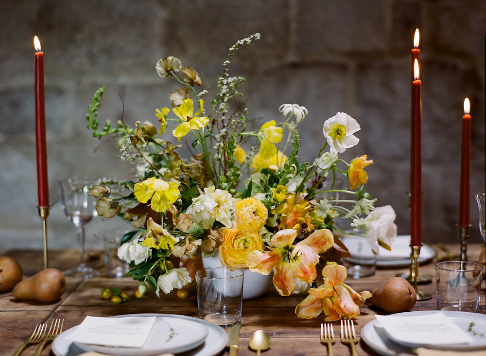 green and yellow centerpieces - photo by Taken by Sarah Photography http://ruffledblog.com/intimate-rustic-chic-wedding-inspiration