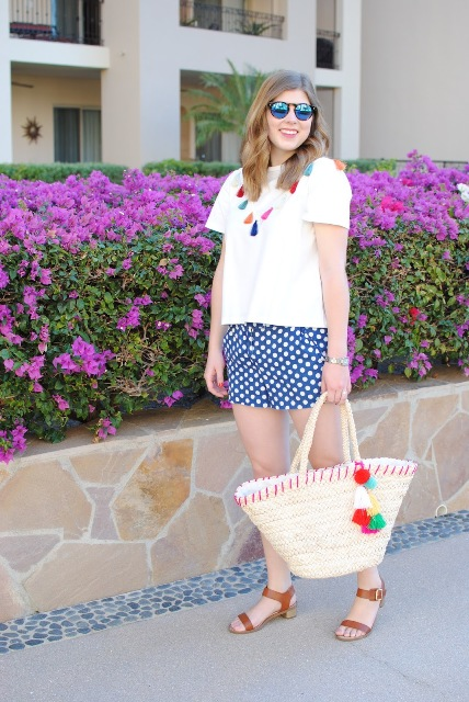 With white t-shirt, tassel necklace, straw tote and brown sandals