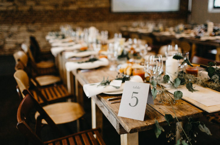 The tablescape was rustic and simple, with greenery garlands and white candles