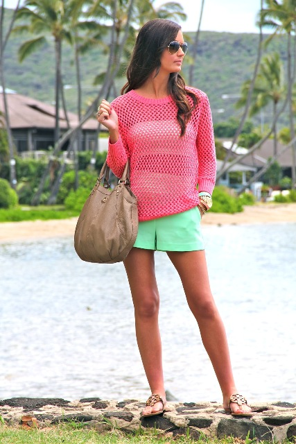 With pink shirt, sandals and leather bag