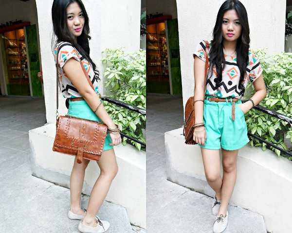 With printed shirt, brown leather belt, white shoes and brown bag