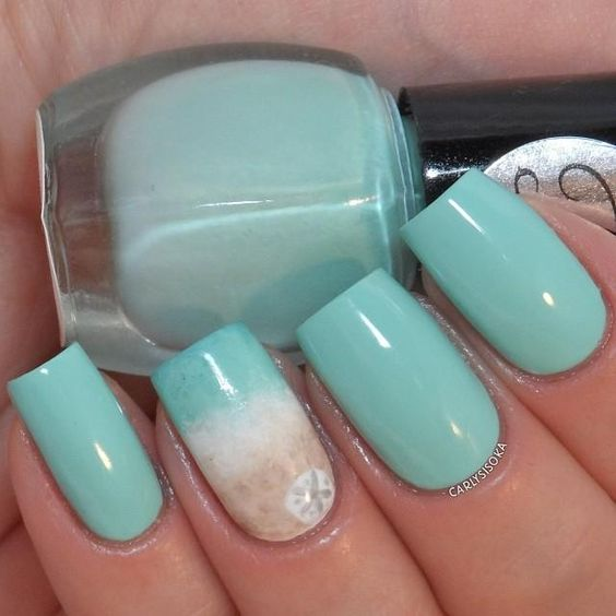 aqua nails with an accent one with beach sand decor and a starfish print