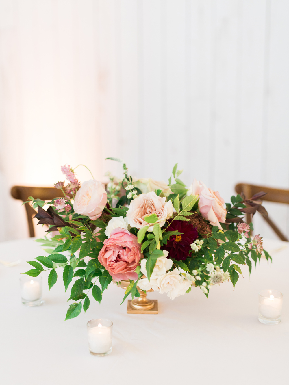 floral centerpieces - photo by Elisabeth Carol Photography http://ruffledblog.com/picturesque-garden-wedding-at-white-sparrow-barn