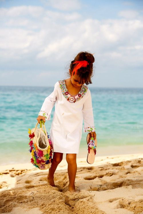 chic beach dress with long sleeves and embellishments as a beach cover up