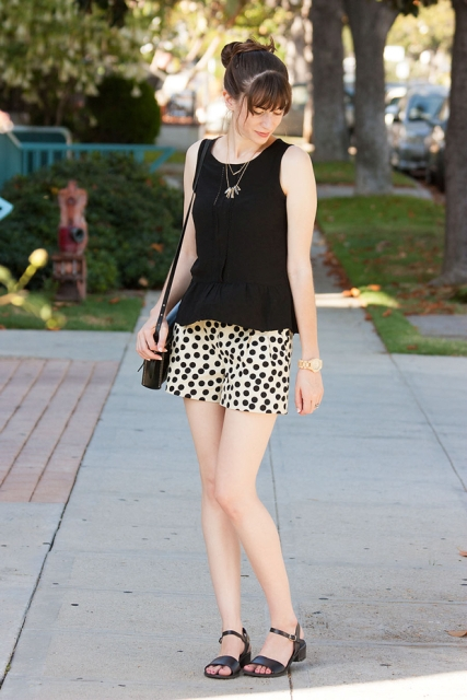 With black top, sandals and mini bag
