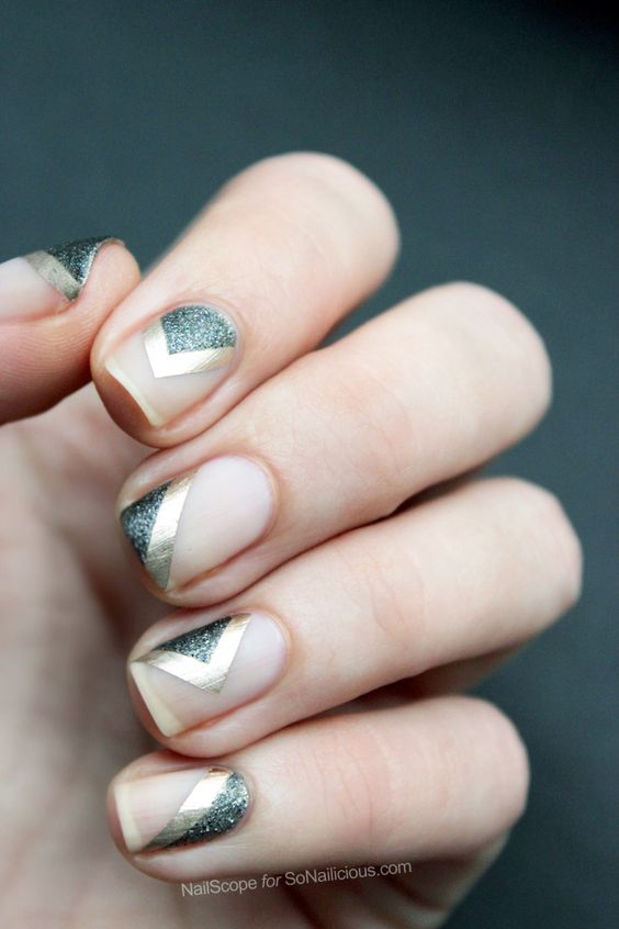 negative space nails with silver glitter and gold sticker stripes
