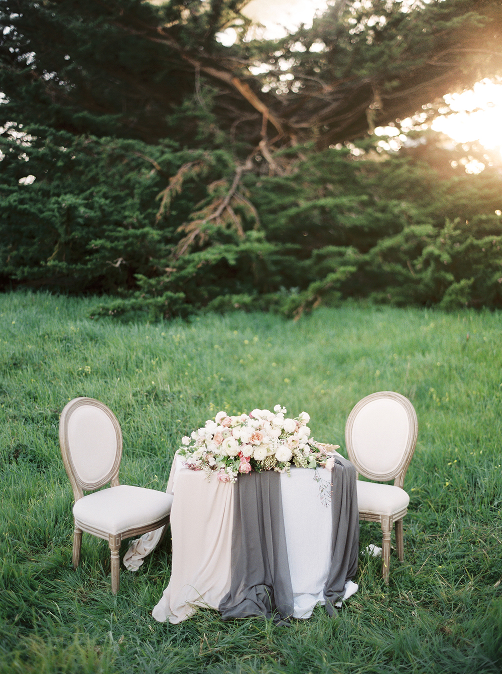 wedding tables - photo by Tyler Rye Photography http://ruffledblog.com/romantic-coastal-california-wedding-inspiration