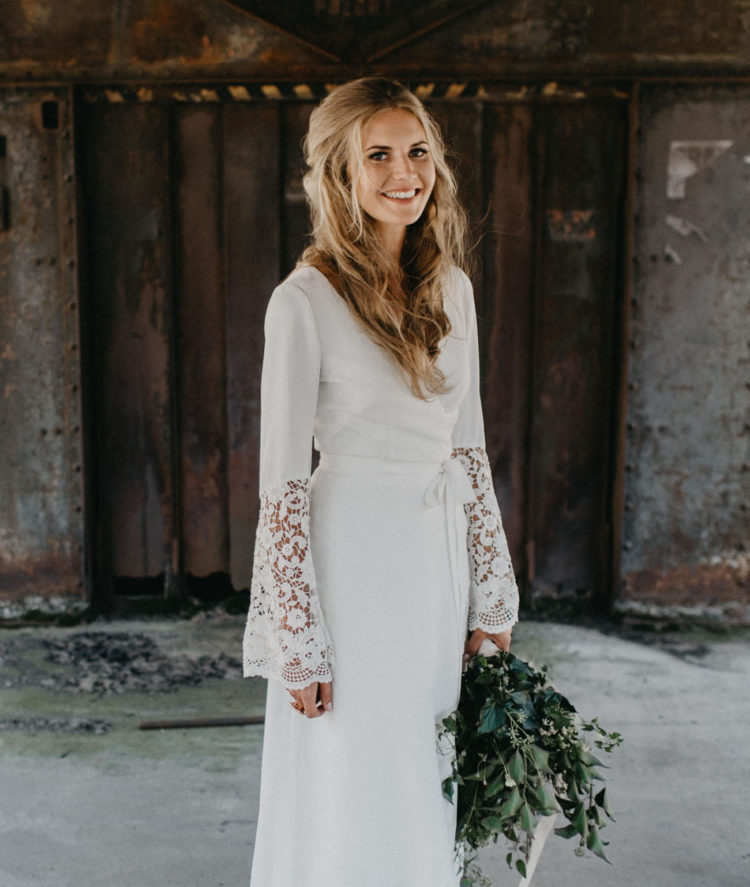 The bride designed her own boho-inspired dress with a V-neck and crocheted bell sleeves