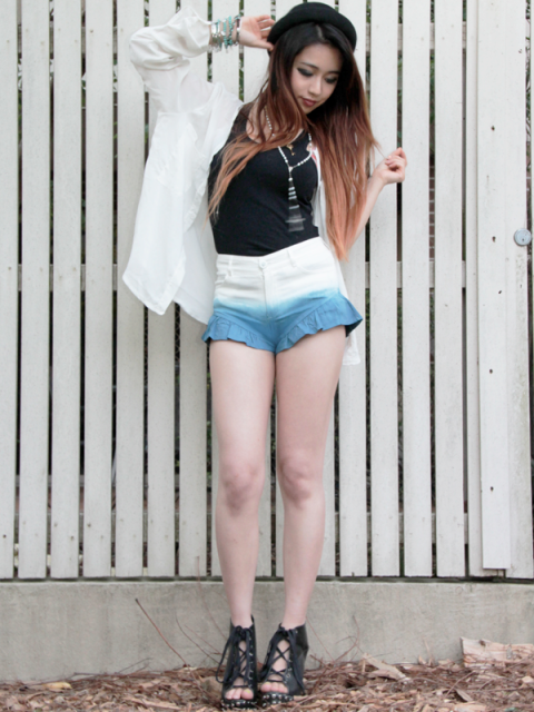 With black top, white shirt and black sandals