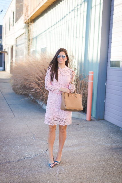 With pale pink lace dress and camel tote