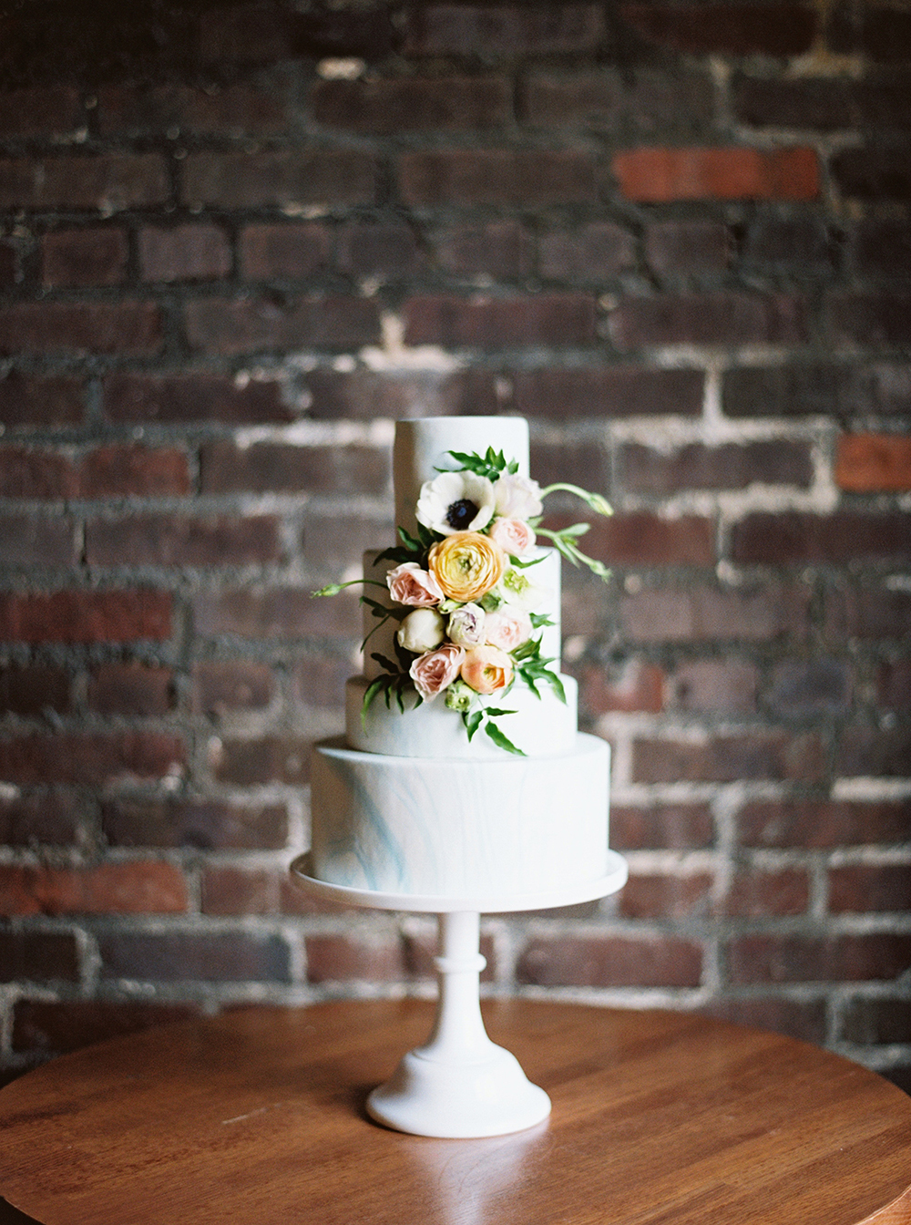 spring wedding cakes - photo by Photos by Heart http://ruffledblog.com/downtown-birmingham-spring-wedding-inspiration