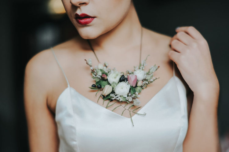 Floral jewelry is one of the hottest trends, and the bride was rocking a gorgeous necklace