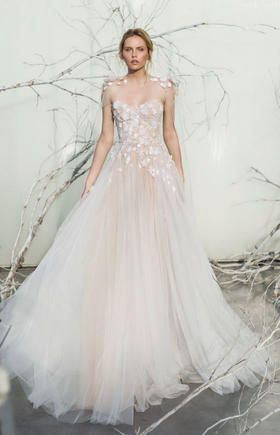 blush tulle ballgown with an illusion bodice and white floral appliques on the shoulders and bodice