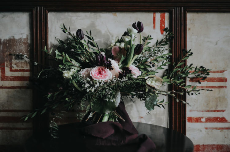 The wedding bouquet was textural, with lots of greenery, pink blooms and dark purple tulips