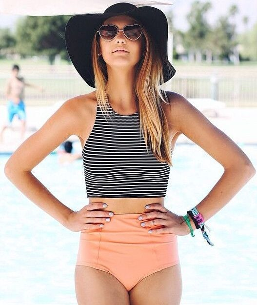 a two piece swimsuit with a peachy high waist bottom and a striped halter top