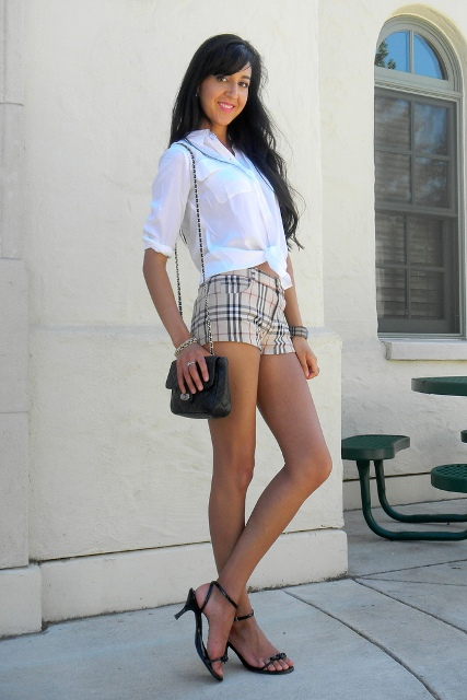 With white shirt, chain strap bag and kitten heels