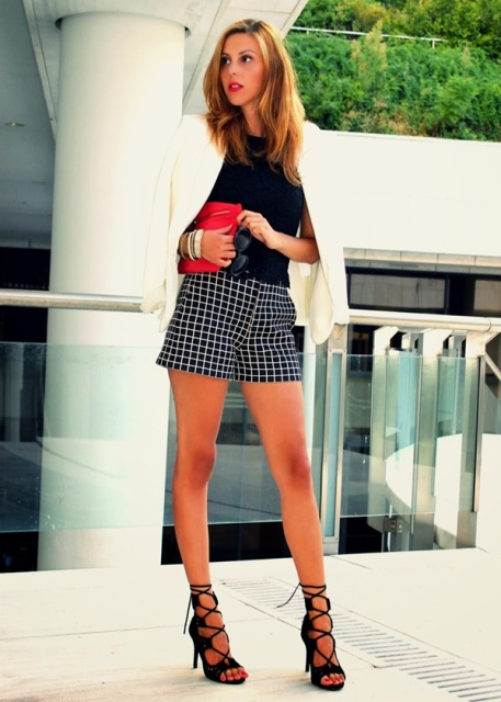 With black shirt, white blazer, red clutch and black lace up sandals