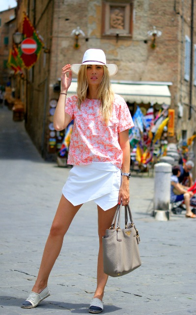 With floral shirt, wide brim hat, gray bag and espadrilles
