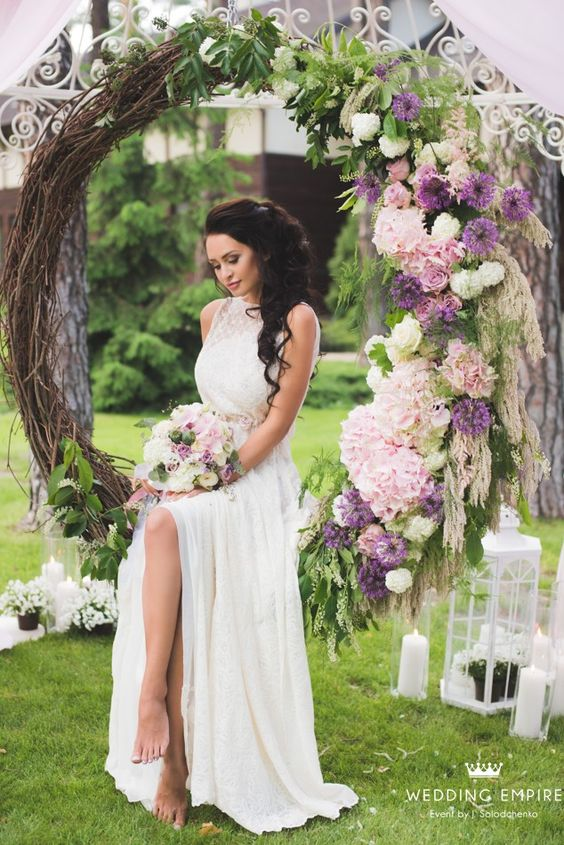a large scale wreath with leaves and flowers as a bridal swing