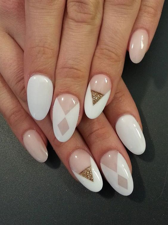 blush and white nails with geometric design with gold glitter accent