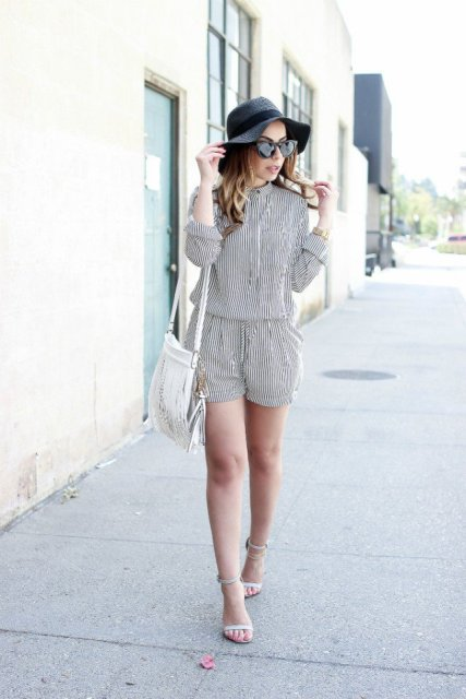 With black wide brim hat, white bag and white sandals
