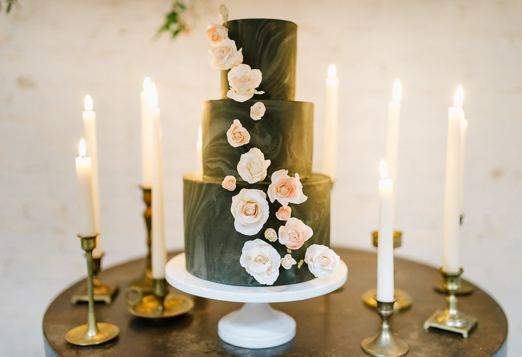 black wedding cakes with flowers - photo by Chelsea Dier Photography http://ruffledblog.com/modern-san-francisco-winery-elopement