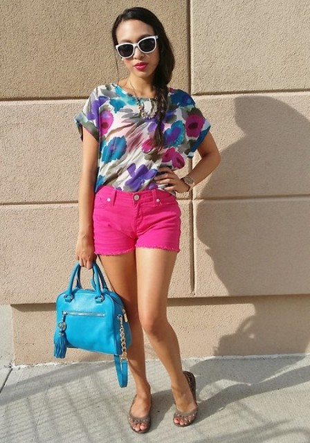 With floral colorful blouse, blue bag and flat shoes