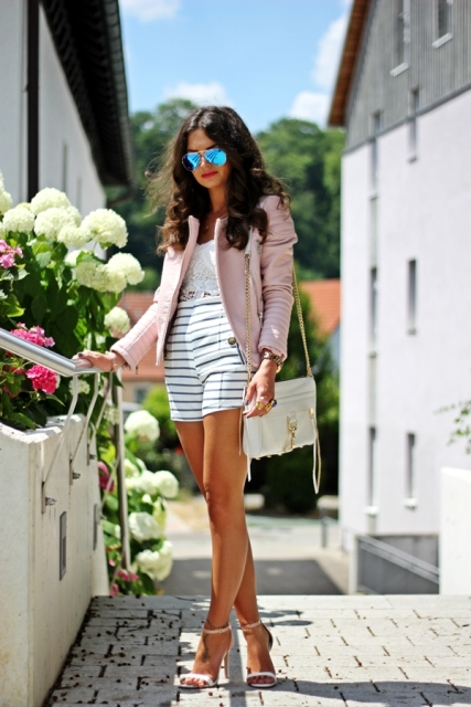 With lace crop top, light pink jacket, white bag and heels