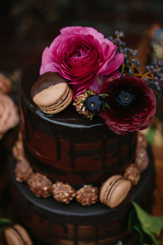 red velvet chocolate drip wedding cake with fresh blooms and macarons