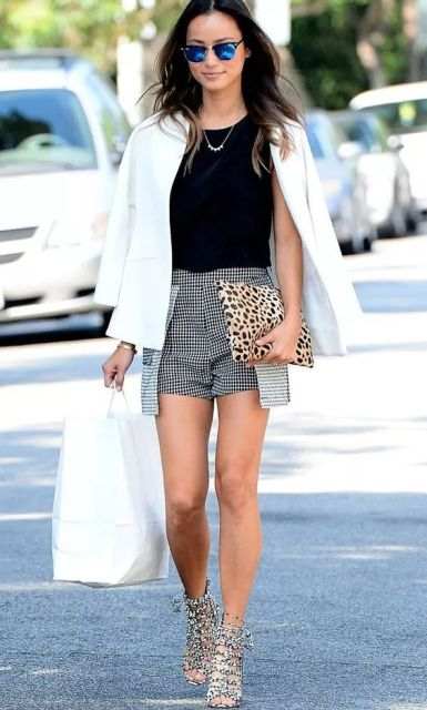 With black top, white blazer, leopard clutch and heels
