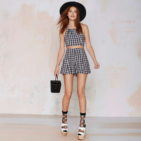 With checked crop top, black hat and platform sandals