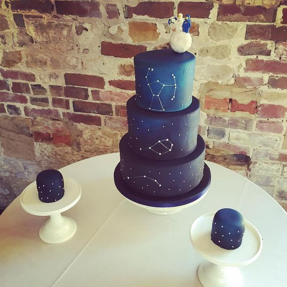 a navy constellation wedding cake and smaller cakes