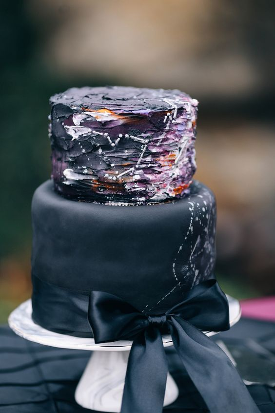 black and deep purple wedding cake with white constellation decor and a black ribbon