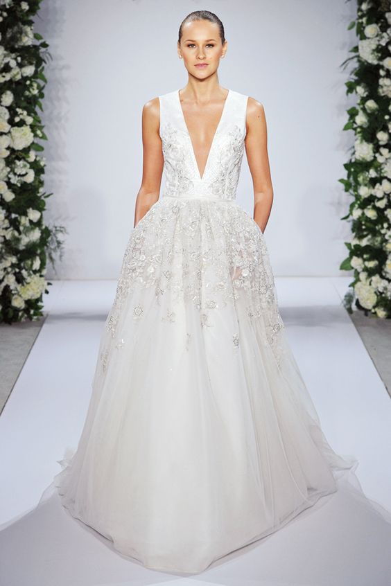 pure white plunging neckline wedding dress with lace appliques and pockets