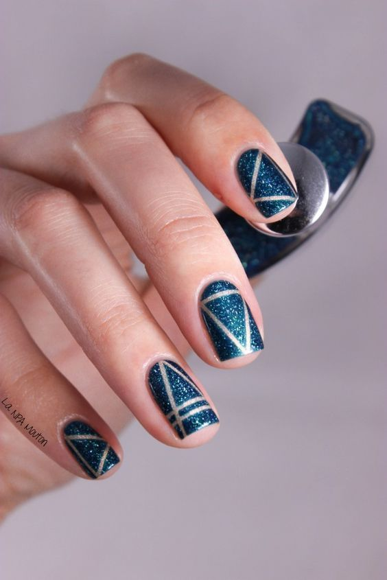 blue glitter nails with silver stripes