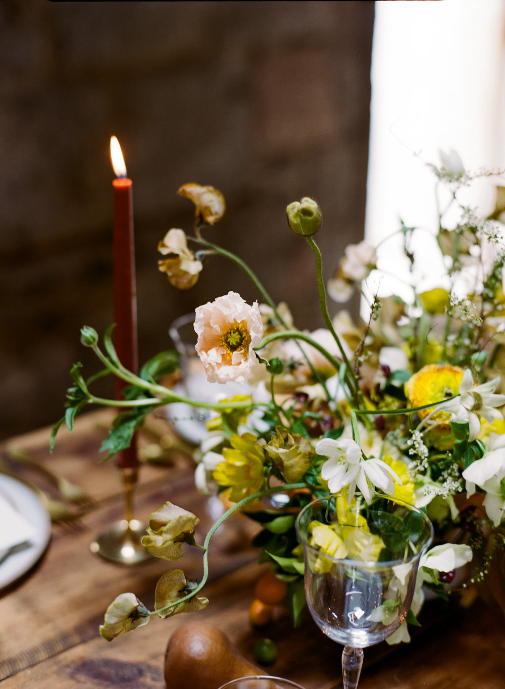 yellow and green centerpieces - photo by Taken by Sarah Photography http://ruffledblog.com/intimate-rustic-chic-wedding-inspiration