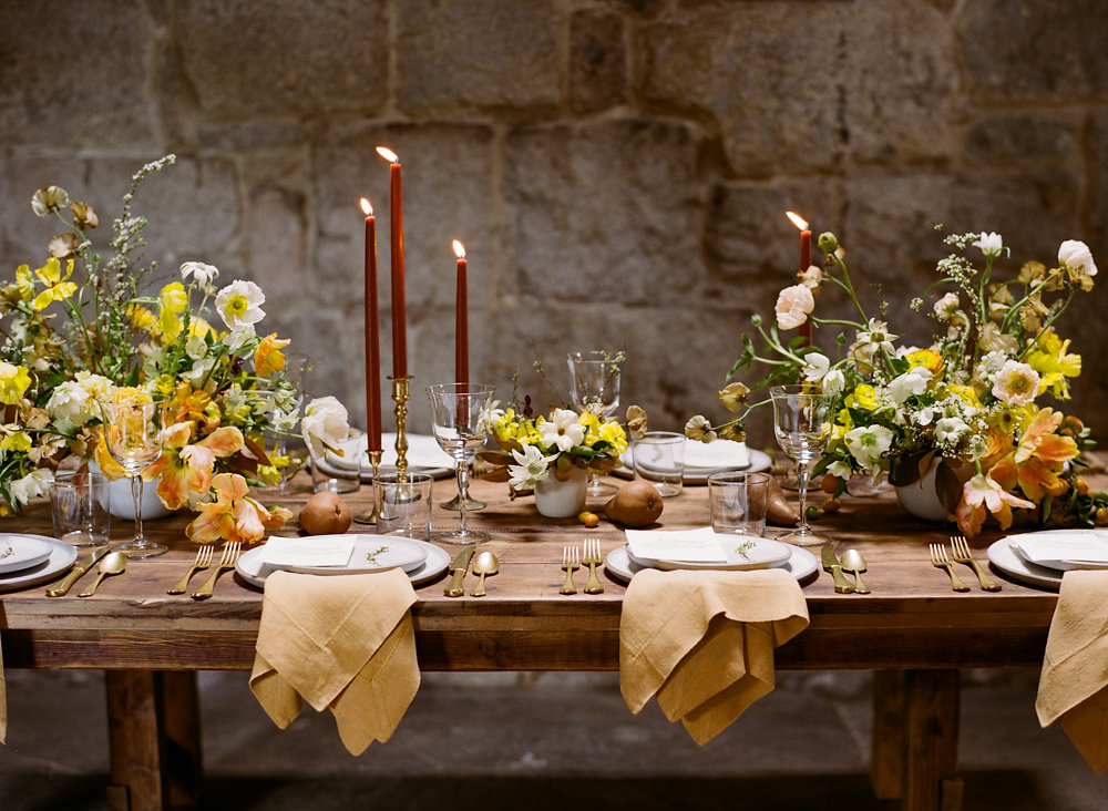 wedding tables - photo by Taken by Sarah Photography http://ruffledblog.com/intimate-rustic-chic-wedding-inspiration