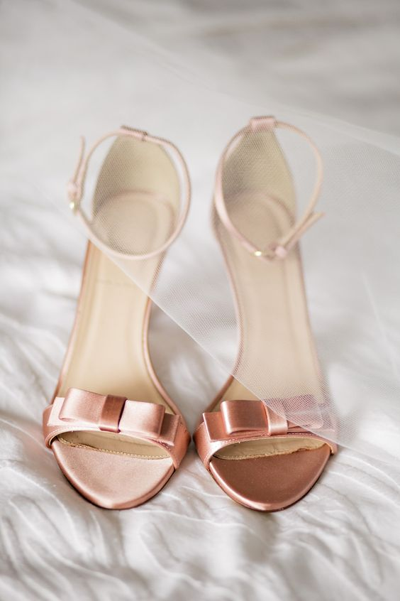 copper colored small bow heeled sandals