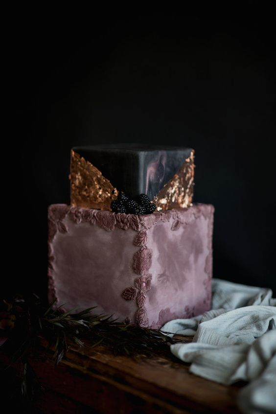mauve and black wedding cake with gold leaf decor and icing flowers and blackberries