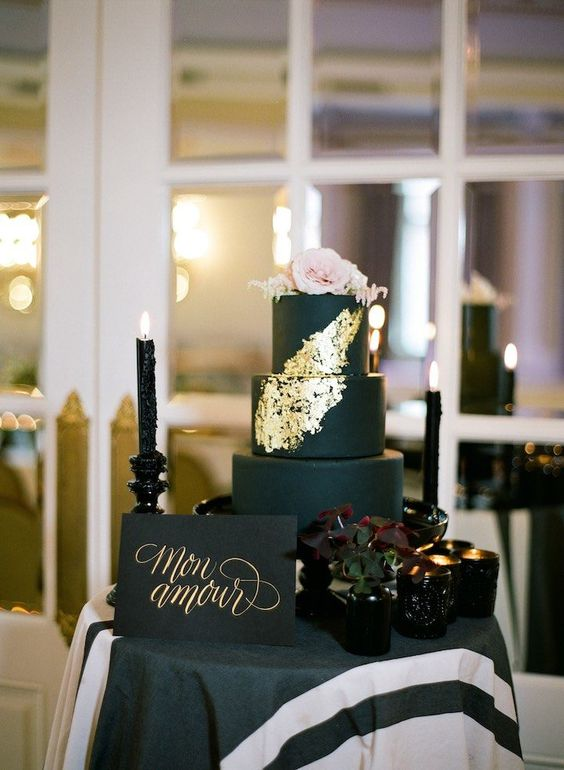 matte black wedding cake with gold touches and blush roses