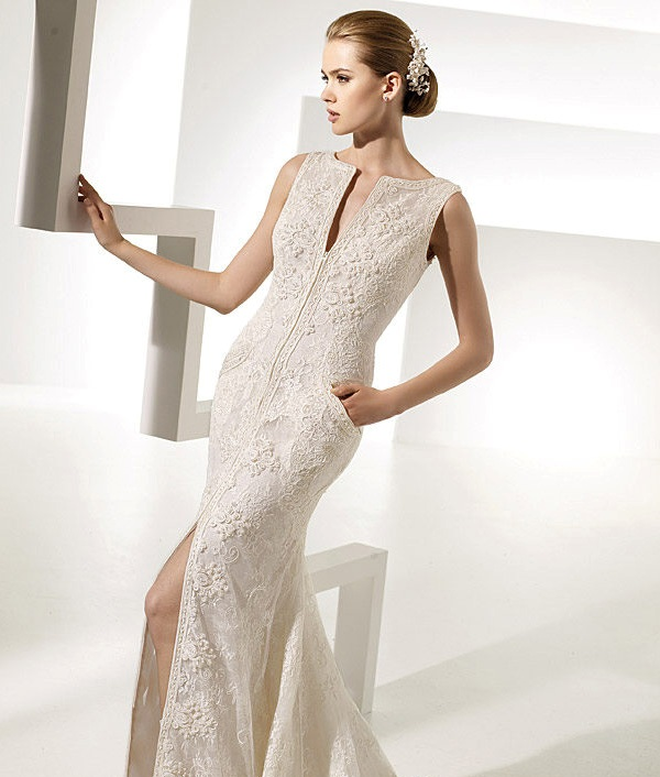 textural lace fitting wedding dress with a plunging neckline, a front slit and pockets